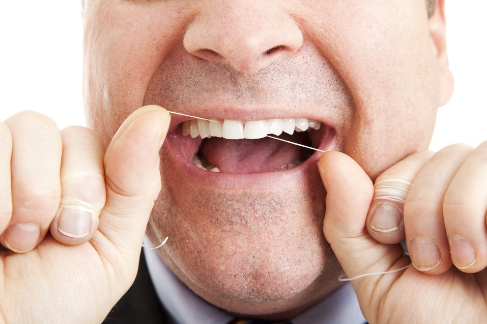 Prevent bleeding gums by flossing properly