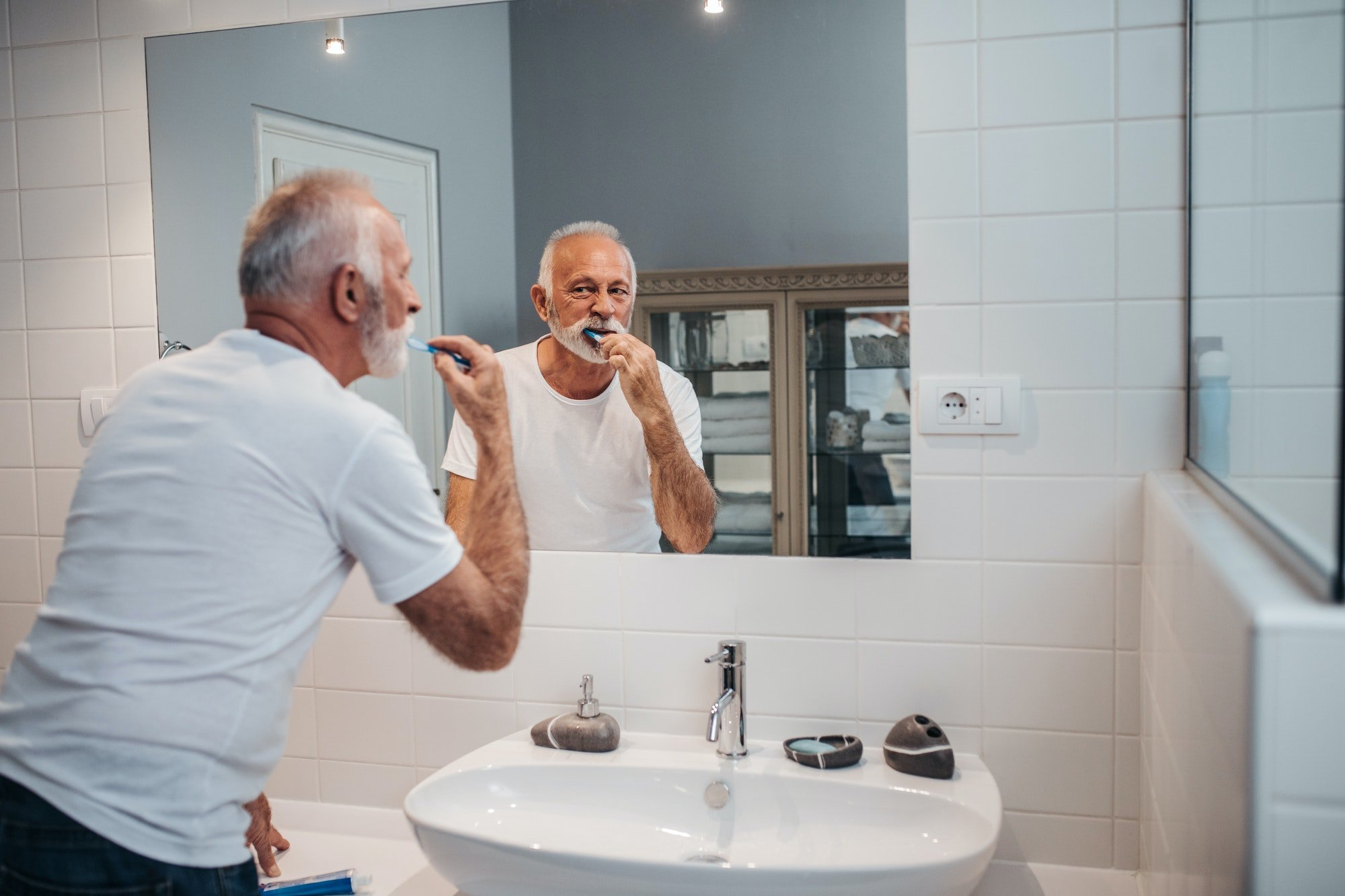 When should adults aged 40 need dental implants